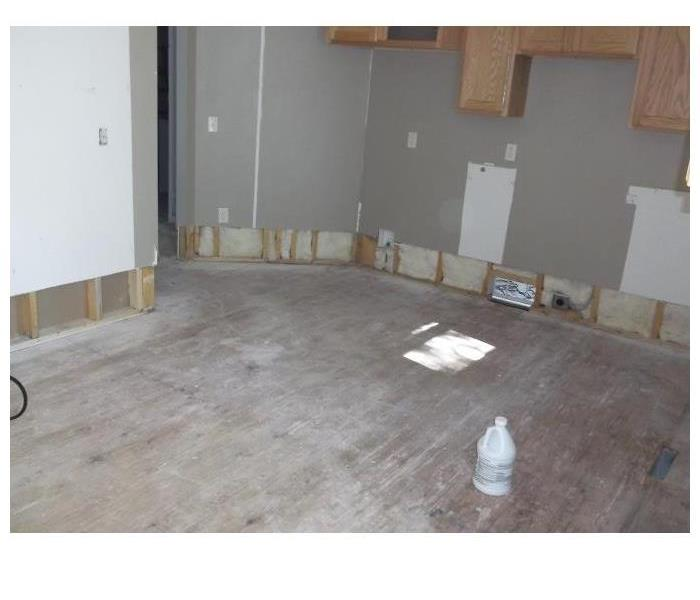 Kitchen area after demolition and dry out due to refrigerator water line break.