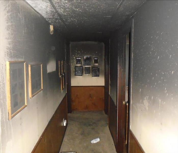 Hallway soot stained from fire.