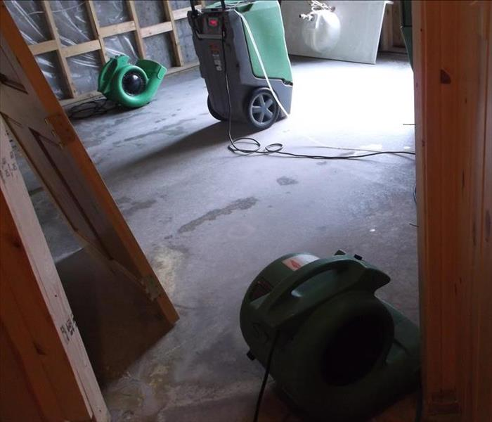 Picture of a room after water removal with equipment placed from drying